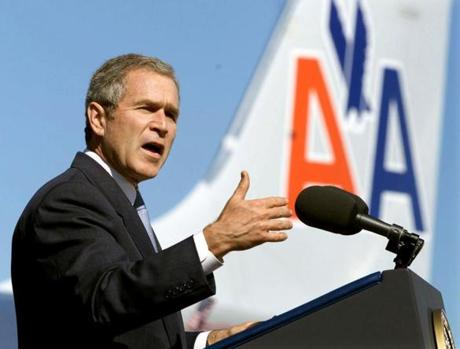 President George W. Bush speaks to airline employees during a visit to Chicago's O'Hare Airport, one of the world's busiest airports, September 27, 2001. Hoping to allay Americans' fear of flying after four hijack attacks, Bush used the visit to unveil plans for more armed sky marshals, stricter security screening and fortified cockpits. REUTERS/Kevin Lamarque FOR BOSTONGLOBE.COM GALLERY ONLY!!!!!! airlinegallery